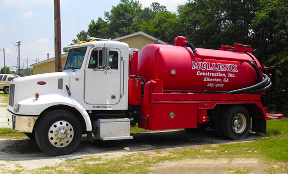 mullenix septic tank service installation and repair truck